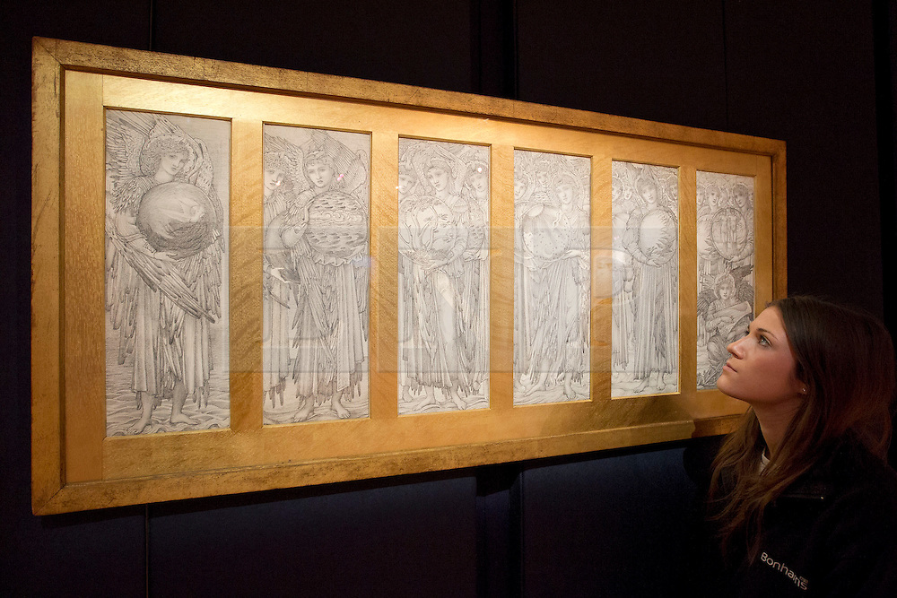 © Licensed to London News Pictures. 15/01/2013. London, UK. A Bonhams employee views 'The Days of Creation' (1871) (Est. GB£150,000 - 250,000), a rarely seen pencil study by British artist Edward Coley Burne Jones, at an auction press view held today (15/01/13) at Bonhams in New Oxford Street, London. The auction, entitled '19th Century Paintings, Drawings and Watercolours', will take place on the 23rd of January at Bonhams' 101 New Bond Street Premisses. Photo credit: Matt Cetti-Roberts/LNP