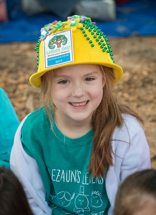 A student wears a construction hat decorated for a groundbreaking ceremony at Garden Oaks Montessori, February 17, 2017.