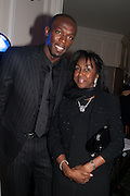 USAIN BOLT; THERESA ROBERTS, Fundraising Gala for the Zeitz foundation and Zoological Society of London hosted by Usain Bolt. . London Zoo. Regent's Park. London. 22 November 2012.