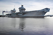 Aircraft Carrier HMS Queen Elizabeth at the naval dockyard in Rosyth as it leaves the dry dock for the first time.<br /> <br /> <br /> © John Linton<br /> All rights reserved