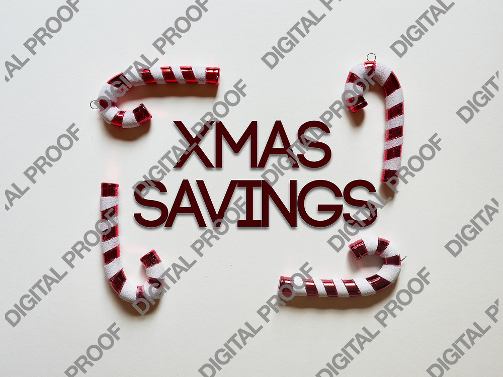 Christmas candy cane drums  at studio above view over a white background isolated flatlay with xmas saving text