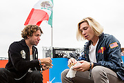 Queens, NY - October 2, 2016. Danny Miller (L) and Max Harwood of the band Lewis del Mar trying tacos from Tortas Neza at The Feastival of Queens at The Meadows festival at Citi Field.