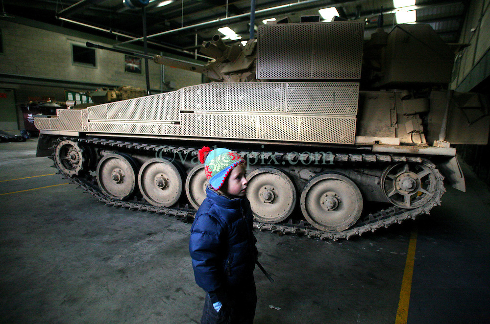 30 December 2009. Great Britain. .Ministry of Defence warehousing for armoured vehicles being trained on, repaired and readied for battle in Afghanistan. .Photo; Charlie Varley.