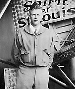 Charles Lindbergh (1902-1974) in his flying kit standing by 'Spirit of St Louis', the plane in which he made the first non-stop Atlantic air  crossing: 20-21 May 1927. Landed at Le Bourget Airdrome, Paris, after a flight of 33.5 hours.