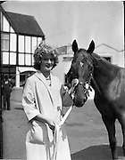 """02/08/1960<br /> 08/02/1960<br /> 02 August 1960<br /> R.D.S Horse Show Dublin (Tuesday). Miss Margaret McVeigh, Lakesideview, Carrickmannon, Co. Down with her fathers prize winning thoroughbred yearling """"Carrickmannon"""" at the Dublin Horse Show."""