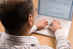 Man using a laptop computer,