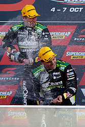 October 7, 2018 - Bathurst, NSW, U.S. - BATHURST, NSW - OCTOBER 07: Race Winners Craig Lowndes / Steven Richards in the Autobarn Lowndes Racing Holden Commodore on the podium at the Supercheap Auto Bathurst 1000 V8 Supercar Race at Mount Panorama Circuit in Bathurst, Australia on October 07, 2018 (Photo by Speed Media/Icon Sportswire) (Credit Image: © Speed Media/Icon SMI via ZUMA Press)