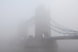 © Licensed to London News Pictures. 12/12/2012. London, UK. Tower Bridge in London is barely visible through thick freezing fog this morning, 12 December 2012. Photo credit : Vickie Flores/LNP.