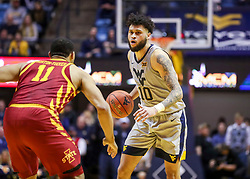 Mar 6, 2019; Morgantown, WV, USA; West Virginia Mountaineers guard Jermaine Haley (10) dribbles during the second half against the Iowa State Cyclones at WVU Coliseum. Mandatory Credit: Ben Queen-USA TODAY Sports