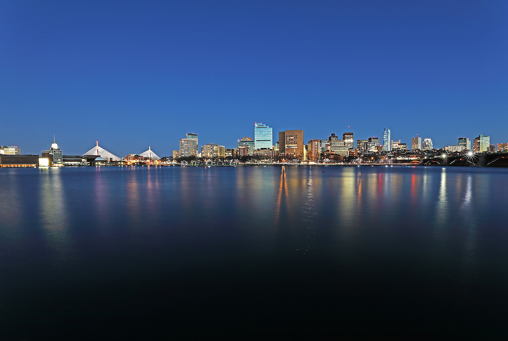 Boston night photography showing familiar Boston landmarks at twilight. From left to right one can see the Museum of Science, the Zakim Bridge or Bunker Hill Bridge, Massachusetts General Hospital in the West End, Beacon Hill with its iconic Massachusetts State House, Longfellow Bridge and the newly constructed Millennium Tower in Downtown Crossing. Boston skyline photos are available as museum quality photography prints, canvas prints, acrylic prints, wood prints or metal prints. Fine art prints may be framed and matted to the individual liking and decorating needs:<br />  <br /> http://juergen-roth.pixels.com/featured/mgh-warren-building-juergen-roth.html<br /> <br /> All photos are available for photography picture licensing at www.RothGalleries.com. Please contact me direct with any questions or request.<br /> <br /> Good light and happy photo making!<br /> <br /> My best,<br /> <br /> Juergen<br /> Prints: http://www.rothgalleries.com<br /> Photo Blog: http://whereintheworldisjuergen.blogspot.com<br /> Instagram: https://www.instagram.com/rothgalleries<br /> Twitter: https://twitter.com/naturefineart<br /> Facebook: https://www.facebook.com/naturefineart