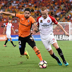 BRISBANE, AUSTRALIA - JANUARY 28: Jack Clisby of the Wanderers and Dimitri Petratos of the Roar compete for the ball during the round 17 Hyundai A-League match between the Brisbane Roar and Western Sydney Wanderers at Suncorp Stadium on January 28, 2017 in Brisbane, Australia. (Photo by Patrick Kearney/Brisbane Roar)
