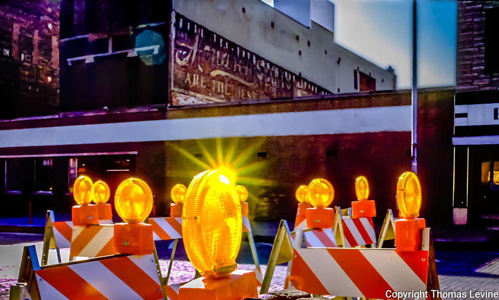 Road construction during the 1970's in Omaha NE with yellow lights and orange barracades. original film 1976