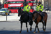 Police officers on horseback patrol in Trafalgar Square in London, Wednesday, March 25, 2020. British lawmakers voted to shut down Parliament for one month from Wednesday due to the coronavirus outbreak. (Photo/Vudi Xhymshiti)