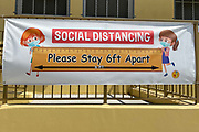 A social distancing sign with coronavirus COVID-19 safety precautions at Morris K. Hamasaki Elementary School, Thursday, July 1, 2021, in Los Angeles.