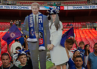 Football - 2018 FA Cup Final - Chelsea vs. Manchester United<br /> <br /> Fans hold a cut of of HRH prince Harry (Duke of Sussex) and his new wife Miss Meghan Markle at Wembley Stadium.<br /> <br /> COLORSPORT/DANIEL BEARHAM