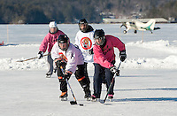 New England Pond Hockey Classic on Lake Waukewan Meredith, NH February 5, 2012.