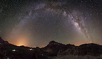 A multi shot pano of the Milky way over the Volcano of El Tiede with the Parador hotel in the foreground