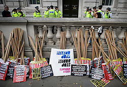 © Licensed to London News Pictures. 31/08/2019. London, UK. Large police numbers and banners lie in the street near 10 Downing Street in Westminster, central London to demonstrate as part of a nationwide 'Stop The Coup' day of action against Boris Johnson's plans to suspend parliament. More than 80 demonstrations are planned across the UK in response to government plans to prorogue parliament. Photo credit: Ben Cawthra/LNP