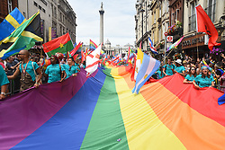 July 8, 2017 - London, United Kingdom - A giant rainbow flag and tens of National flags are weaved down Whitehall during the Pride in London Festival, London on July 8, 2017. The Pride in London Festival sees hundreds of thousands of people take to the streets in celebration and support of the LBGT+ community. This year's London Pride event marks 50 years since homosexuality was decriminalised in England and Wales under the 1967 Sexual Offences Act. (Credit Image: © Alberto Pezzali/NurPhoto via ZUMA Press)