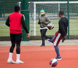 © Licensed to London News Pictures. 31/03/2020. London, UK. People exercise and play football at Paddington Recreation Ground in London, during a lockdown to slow the spread of COVID-19. Members of the public have been told they can only leave their homes when absolutely essential, in an attempt to fight the spread of COVID-19, . Photo credit: Ben Cawthra/LNP
