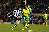 WBA's Shane Long has a shot at goal.  Barclays Premier league, West Bromwich Albion v Norwich city at the Hawthorns in West Bromwich, England on Sat 7th Dec 2013. pic by Andrew Orchard, Andrew Orchard sports photography.