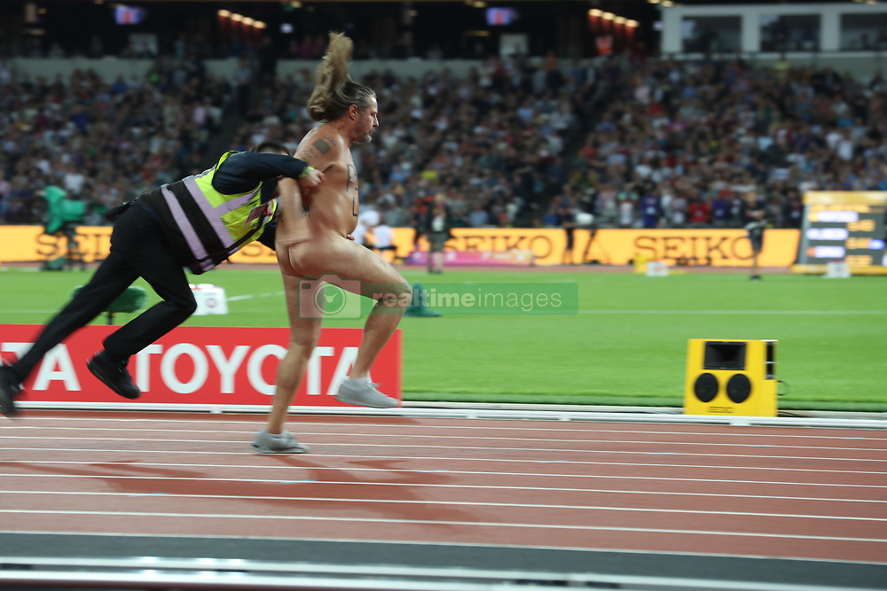 August 5, 2017 - London, England - A naked man, resplendent with ''PEACE and LOVE'' blazoned across his chest, streaked roughly 40 metres in 14 seconds at the London Stadium right before the much anticipated, closing event of day two of the IAAF World Championships, the 100 Meters Men's race. The long-haired, solidly built middle-aged man wasn't in an official race. The streaker didn't even make it to the finish line - cruelly tackled from behind by a steward he had just shown a clean pair of heels with a surprisingly agile right-foot step. On his back, he had written ''DRUG FREE for Mum''. (Credit Image: © Scott Mc Kiernan via ZUMA Wire)