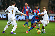 Wayne Routledge of Swansea city ® is challenged by Wilfried Zaha of Crystal Palace. Barclays Premier league match, Swansea city v Crystal Palace at the Liberty Stadium in Swansea, South Wales on Saturday 6th February 2016.<br /> pic by Andrew Orchard, Andrew Orchard sports photography.