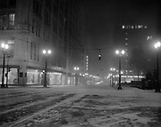 Y-500103-01.  Portland SW Morrison at Broadway looking east, at night in snow, January 3, 1950