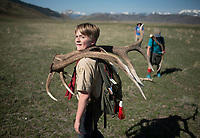 Shane Zimmerman of Boy Scout Troop 67 carries a set of antlers he found Saturday morning on the National Elk Refuge while gathering the sheds. The antlers will be bundled and sold at ElkFest on May 19, with proceeds helping to support feeding and habitat enhancement projects on the refuge.