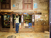 06 AUGUST 2015 - KATHMANDU, NEPAL: A man looks into a small shop near Durbar Square in Kathmandu.       PHOTO BY JACK KURTZ