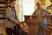 Easter in Southern Styria, Austria. Buschenschank Gutjahr. Traditional demon mask.