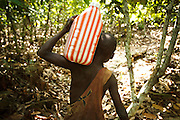 Firimin Kouassi, 13, walks back from fetching water on his uncle's cocoa plantation near the town of Moussadougou, Bas-Sassandra region, Cote d'Ivoire on Monday March 5, 2012.
