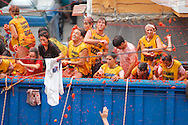 """People celebrates the """"Tomatina"""" on August 31th, 2005 in Bunyol, Valencia, Spain. Approximately 45,000 people pelted each other with around 100.000 kilograms of tomatoes. The """"Tomatina"""" is known as the world's largest tomato battle. (Ander Gillenea / Bostok Photo)"""