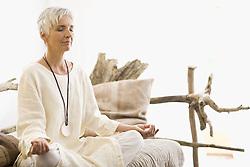 Jul. 08, 2009 - meditating woman. Model Released (MR) (Credit Image: © Cultura/ZUMAPRESS.com)