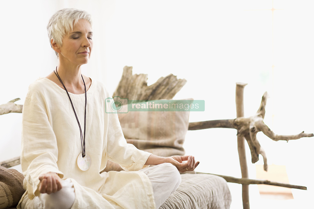 Jul. 08, 2009 - meditating woman. Model Released (MR) (Credit Image: © Cultura/ZUMAPRESS.com)