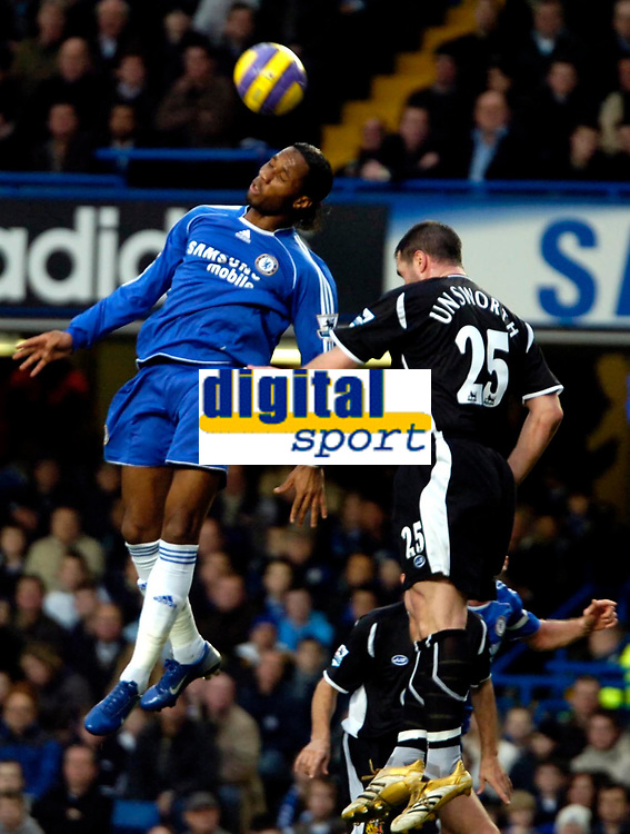 Photo: Ed Godden/Sportsbeat Images.<br />Chelsea v Wigan Athletic. The Barclays Premiership. 13/01/2007. Chelsea's Didier Drogba (L), leaps high to beat David Unsworth to the ball.