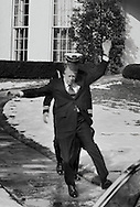President Jimmy Carter slipping on his first day at workd as president of the US. January 21,1977.  Photo by Dennis Brack