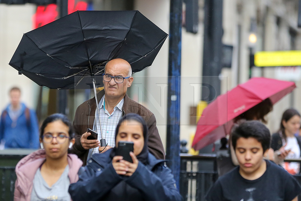 © Licensed to London News Pictures. 27/09/2019. London, UK. A man on Regents Street struggles with the umbrella during rain and wet weather. According to the Met Office, this weekend is set to be washout with over 2o hours of rainfall in the capital. Photo credit: Dinendra Haria/LNP