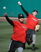 Richmond Flying Squirrels pitcher Connor Overton, front, warms up with teammates before a game against the Hartford Yard Goats at Dunkin' Donuts Park in Hartford, Conn.