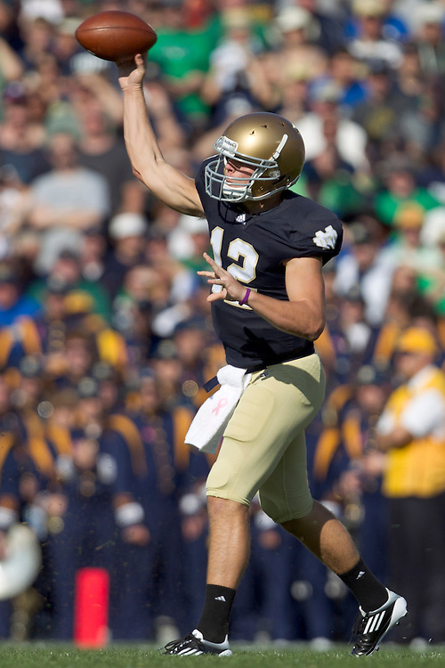 Notre Dame quarterback Andrew Hendrix (#12) passes the ball in action during NCAA football game between Notre Dame and Air Force.  The Notre Dame Fighting Irish defeated the Air Force Falcons 59-33 in game at Notre Dame Stadium in South Bend, Indiana.
