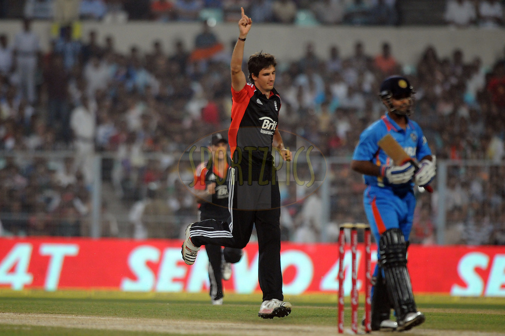 Steven Finn of England celebrates the wicket of Ajinkya Rahane of India during the T20 International match between India and England held at the Eden Gardens Stadium, Kolkata on the 29th October 2011..Photo by Pal Pillai/BCCI/SPORTZPICS