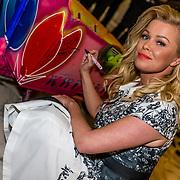 NLD/Amsterdam//20170410 - Free a Girl Celebrity Night, Bridget Maasland signeert een bakfiets