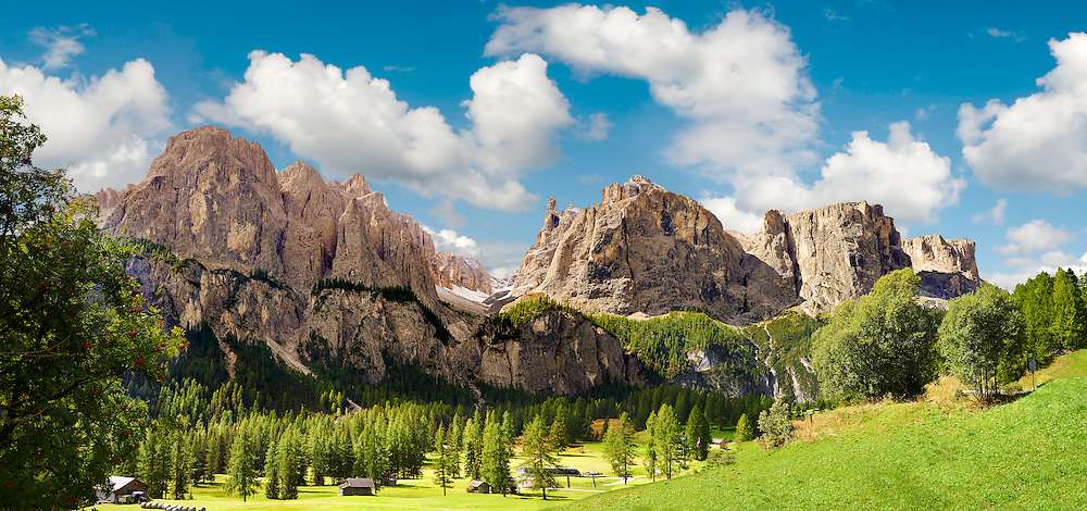 Mountains and pastures of the Sella plateau near Colfosco, 1,645 m (5,396 ft),  at the foot of the Sella group (Grup dl Sela) and Mount Sassongher, the Dolomite mountains, Alta Badia, Italy .<br /> <br /> Visit our ITALY PHOTO COLLECTION for more   photos of Italy to download or buy as prints https://funkystock.photoshelter.com/gallery-collection/2b-Pictures-Images-of-Italy-Photos-of-Italian-Historic-Landmark-Sites/C0000qxA2zGFjd_k<br /> If you prefer to buy from our ALAMY PHOTO LIBRARY  Collection visit : https://www.alamy.com/portfolio/paul-williams-funkystock/dolomite-mountains-italy.html