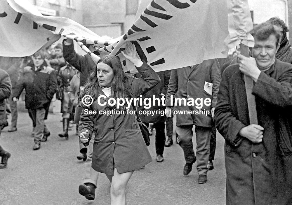 Mid-Ulster Independent MP, Bernadette Devlin, leads the banned Dungannon Civil Resistance Committee march to Coalisland on 23rd January 1972. A ban on all marches during 1972 was imposed by Ulster Unionist Prime Minister Brian Faulkner on 18 January 1972. 197201230027d.<br /> <br /> Copyright Image from Victor Patterson, Belfast, UK<br /> <br /> t: +44 28 9066 1296 (from Rep of Ireland 048 9066 1296)<br /> m: +44 7802 353836<br /> e: victorpattersonbelfast@gmail.com<br /> <br /> www.images4media.com<br /> <br /> Please see my full Terms and Conditions of Use at https://www.images4media.com/p/terms-conditions - it is IMPORTANT that you familiarise yourself with them.<br /> <br /> Images used online incur an additional cost. This cost should be agreed in writing in advance. Online images must be visibly watermarked i.e. © Victor Patterson or that of the named photographer within the body of the image. The original metadata must not be deleted from images used online.<br /> <br /> This image is only available for the use of the download recipient i.e. television station, newspaper, magazine, book publisher, etc, and must not be passed on to a third party. It is also downloaded on condition that each and every usage is notified within 7 days to victorpattersonbelfast@gmail.com.<br /> <br /> The right of Victor Patterson (or the named photographer) to be identified as the author is asserted in accordance with The Copyright Designs And Patents Act (1988). All moral rights are asserted.