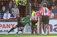 Photo: Daniel Hambury.<br />Brentford v Bristol City. Coca Cola League 1. 07/10/2006.<br />Brentford's Kevin O' Connor (R) scores from the spot. 1-1.