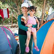 """Jeilan, 28 years old, from Aleppo, Syria, with her 4 years old daughter, stays in the Kara Tepe refugee camp on the island of Lesbos. She has already spent 5 days in the camp waiting for her papers to be issued by the police. """"I cannot believe that I am living in such conditions with my family,"""" she says. """"I used to be a teacher back in my country. My husband was an accountant. Look at us now! This is inhumane."""""""