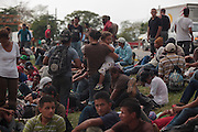 "Central American migrants have to make deadly, irregular and clandestine travels hidden in the wagons and gonads of the train through Mexico during weeks to arrive to the U.S.  The train is nicknamed ""La Bestia"" (The Beast) due to its dangerousness.<br /> <br /> Each Holly Week, along with Mexican human rights activists, make religious and protest activities during the ""Viacrucis del migrante"". <br /> <br /> This year, they walk on foot, since the evening of Thursday April 17th, after the train where they travel, under Ferrocarriles del Istmo enterprise orders, unhooked the gonads with people and left them abandoned in Tenosique. After being left, they made the decision to continue their way on foot. <br /> <br /> They have traveled on foot more than 100 km (328 000 ft) from Tenosique, Tabasco demanding an end to the violence against migrants and free transit through Mexico. (Photo credit: Prometeo Lucero)"