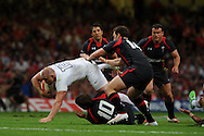 England's Mike Tindall (c) is tackled by Rhys Priestland (10) and George North (14) of Wales . Wales v England, international rugby, World cup warm up match at Millennium Stadium in Cardiff on Sat 13th August 2011. Pic By Andrew Orchard, Andrew Orchard sports photography,