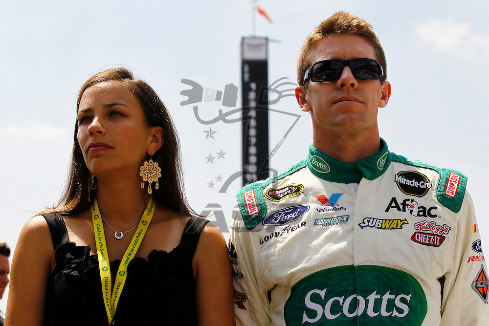 Speedway, IN  - JUL 31, 2011: Carl Edwards (99) stands for the National Anthem before the Brickyard 400 presented by BigMachineRecords.com at Indianapolis Motor Speedway in Speedway, IN.