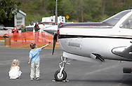Wurtsboro, NY - A young boy reaches toward the propeller of a Beechcraft Bonanza airplane at the grand reopening of Wurtsboro Airport on May 11, 2008.